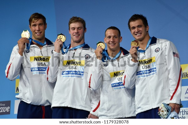 Budapest, Hungary - Jul 30, 2017. Gold medalist USA (GREVERS Matt, CORDES Kevin, DRESSEL Caeleb, ADRIAN Nathan) at the Victory Ceremony of the Men 4x100m Medley Relay. FINA Swimming World Championship