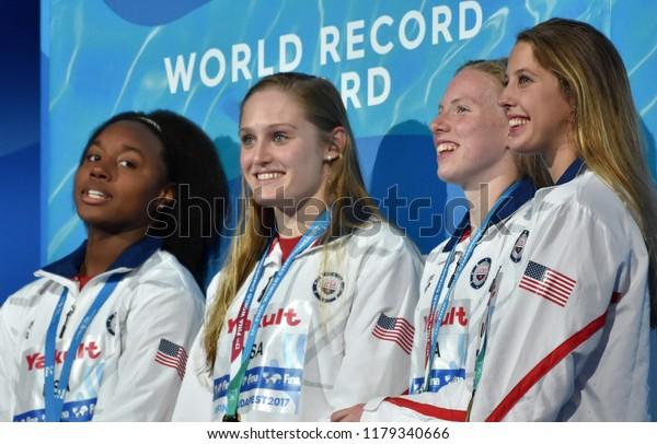 Budapest, Hungary - Jul 30, 2017. World Recorder Team USA (BAKER Kathleen, KING Lilly, WORRELL Kelsi, MANUEL Simone) at the Victory Ceremony of Women Medley 4x100m. FINA Swimming World Championships.