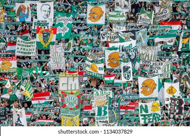 BUDAPEST, HUNGARY - JULY 12, 2018: The ultra fans (called Green Monsters) lift up flags and banners prior to the Ferencvarosi TC v Maccabi Tel Aviv FC UEFA Europa League match  at Groupama Arena.