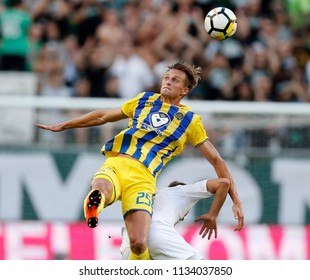 BUDAPEST, HUNGARY - JULY 12, 2018: (l-r) Aaron Schoenfeld battles for the ball in the air with Stefan Spirovski during the Ferencvaros v Maccabi Tel Aviv FC UEFA Europa League match  at Groupama Arena