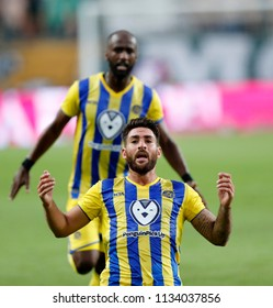 BUDAPEST, HUNGARY - JULY 12, 2018: (r-l) Eliran Atar celebrates his equaliser in front of Eli Dasa during the Ferencvarosi TC v Maccabi Tel Aviv FC UEFA Europa League match  at Groupama Arena.