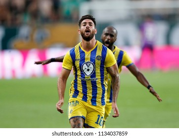 BUDAPEST, HUNGARY - JULY 12, 2018: (l-r) Eliran Atar celebrates his equaliser in front of Eli Dasa during the Ferencvarosi TC v Maccabi Tel Aviv FC UEFA Europa League match  at Groupama Arena.