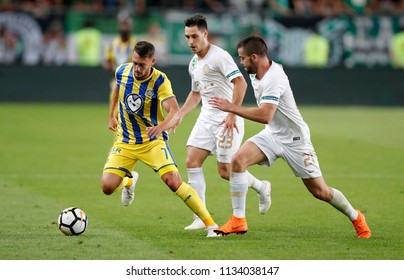 BUDAPEST, HUNGARY - JULY 12, 2018: (l-r) Omer Atzili competes for the ball with Lukacs Bole and Endre Botka during the Ferencvarosi TC v Maccabi Tel Aviv FC UEFA Europa League match  at Groupama Arena