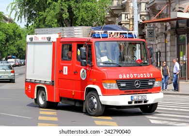 BUDAPEST, HUNGARY - JULY 23, 2014: Red fire truck Mercedes-Benz Vario 816D at the city street.