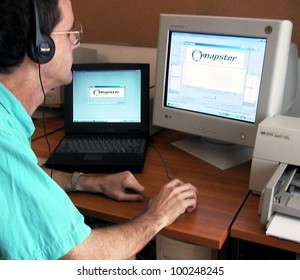 BUDAPEST, HUNGARY - JULY 28: An unidentified man accesses the Napster web site on July 28, 2000 in Budapest Hungary.  Napster worked as a clearinghouse - pointing users to computers where songs in  MP3 format could be downloaded.