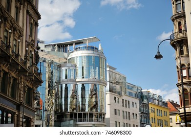 BUDAPEST, HUNGARY, JULY 5, 2014 - view of a street and characteristic modern glass building in the city center