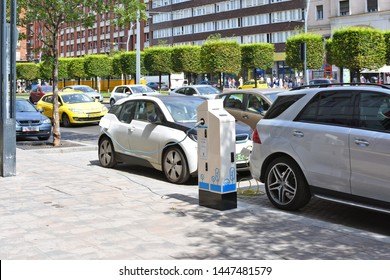 Budapest, Hungary, - July 6, 2019: Electric car charging on the street. Charging stations for electric vehicles.