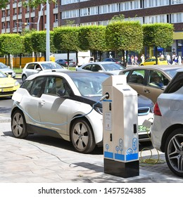 Budapest, Hungary, July 6, 2019: Electric car charging on the street. Charging stations for electric vehicles