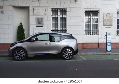 Budapest, Hungary - July 7, 2015: BMW i3 Concept car is charging at the street. Side view