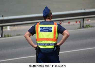 BUDAPEST, HUNGARY - JUNE 03, 2019 Hungarian Police at the bank of river Danube. Road is closed due to preparation of rescue team