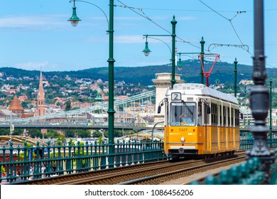 BUDAPEST, HUNGARY - JUNE 07, 2017: Yellow tram number 2 in Budapest near Danube river. Budapest tram network is one of world's largest tram networks.