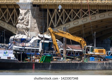 Budapest, Hungary – June 11, 2019; Raising action to the surface of the sunken Hableany tour ship. Grabber supports the safety lifting.