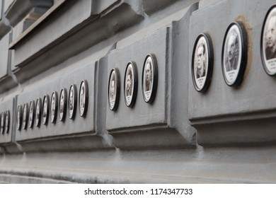 BUDAPEST, HUNGARY - JUNE 19, 2014: Photos of victims of fascist and communist regimes outside House of Terror