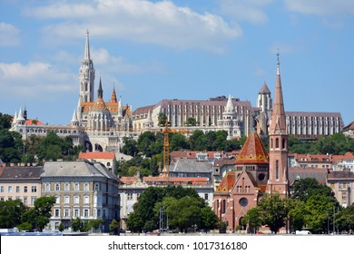 Budapest, Hungary - June 19, 2017: View across the river Danube to the historic buildings in Buda with Matyas church, Fishermen's Bastion and Calvin's church in Budapest - Hungary.
