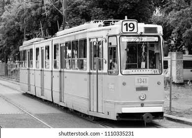 BUDAPEST, HUNGARY - JUNE 20, 2014: People ride tram in Budapest. It is part of BKK public transport system which serves 1.4 billion annual rides (2011).