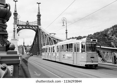 BUDAPEST, HUNGARY - JUNE 20, 2014: People ride orange tram in Budapest. It is part of BKK public transport system which serves 1.4 billion annual rides (2011).