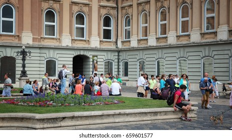 BUDAPEST, HUNGARY - JUNE 20, 2014: People visit Buda Castle in Budapest. It is the largest city in Hungary and 9th largest in the EU (3.3 million people).