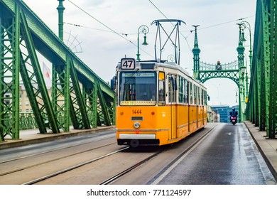 BUDAPEST, HUNGARY - June, 2017: Liberty Bridge or Freedom Bridge and yellow train in Budapest, Hungary.