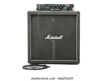 BUDAPEST, HUNGARY - JUNE 22, 2015: Marshall guitar cabinet with 4x12 speakers Hughes and Kettner preamp and power amp.