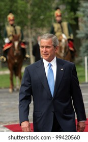 BUDAPEST, HUNGARY - JUNE 22: United States President George W. Bush  reviews a troop of Hungarian Hussars upon his arrival in Budapest, Hungary, on Thursday, June 22, 2006.