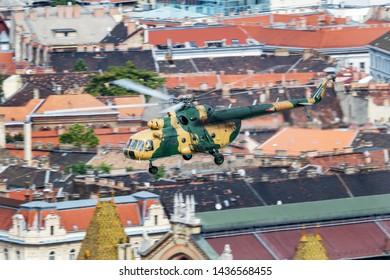 BUDAPEST / HUNGARY - JUNE 24, 2018: Hungarian Air Force Mil Mi-17 704 transport helicopter flying over Danube river in Budapest downtown