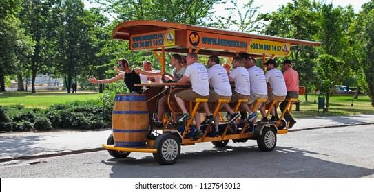 BUDAPEST, HUNGARY, June 27, 2016 : BierBike with tourists on the streets of Budapest, June 27, 2016 in Budapest, Hungary. BierBike is sighseeing tour for tourists.