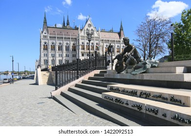 Budapest, Hungary, June 3, 2019. Sitting Statue of Attila József poet near the Hungarian Parliament Building