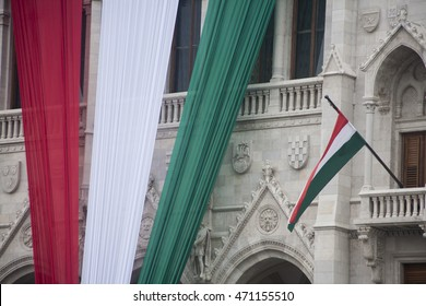 Budapest, Hungary, Kossuth square in front of the Parliament -  August 19, 2016. The Hungarian Nation Flag on the facade of the Parliament building