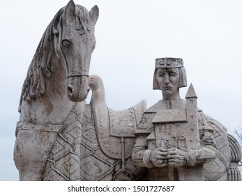 Budapest, Hungary - Mar 9th 2019:  Statue of king and hourse in front of Budapest Cave Church. The Gellért Hill Cave is part of a network of caves within Gellért Hill in Budapest, Hungary.