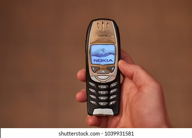 BUDAPEST, HUNGARY - MARCH 01, 2018: Nokia 6310i cellphone showing the nokia welcome screen when starting up. The 6310i was a very popular corporate phone after its introduction in 2002