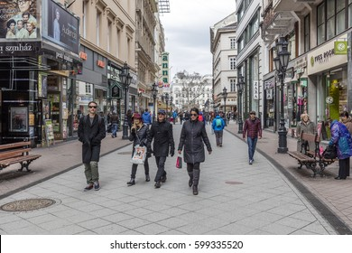 BUDAPEST, HUNGARY - MARCH 12, 2017: People visit Vaci Street. Vaci utca (Vaci street) is one of the main pedestrian thoroughfares and perhaps the most famous street of central Budapest.