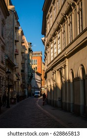 Budapest, Hungary - March 13, 2017: Old narrow street in historical center of Pest on sunset