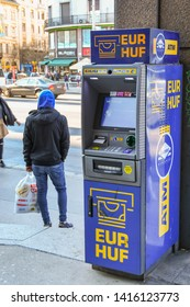 BUDAPEST, HUNGARY - MARCH 2018: Free-standing cash machine for euros or the Hungarian Forint on a street in the centre of Budapest.