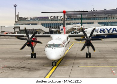 BUDAPEST, HUNGARY - MARCH 2019: Turboprop aircraft with engines running waiting to leave its stand at Budapest airport.