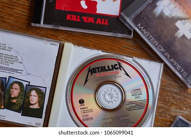 BUDAPEST, HUNGARY - MARCH 21, 2018: Metallica And Justice For All CD release, one of the most classic metal albums from the 80s, in collection with other albums