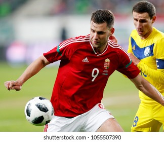 BUDAPEST, HUNGARY - MARCH 23, 2018: Adam Szalai #9 of Hungary competes for the ball with Stanislav Lunin (R) of Kazakhstan during Hungary v Kazakhstan match at Groupama Arena.