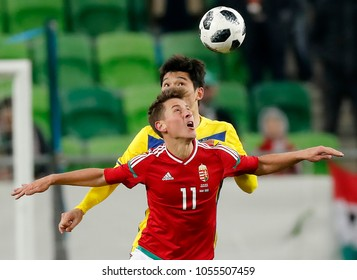 BUDAPEST, HUNGARY - MARCH 23, 2018: Krisztian Nemeth #11 of Hungary battles for the ball in the air with Yeldos Akhmetov (L) of Kazakhstan during Hungary v Kazakhstan match at Groupama Arena.