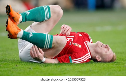 BUDAPEST, HUNGARY - MARCH 23, 2018: Laszlo Kleinheisler #15 of Hungary writhes on the ground during Hungary v Kazakhstan match at Groupama Arena.