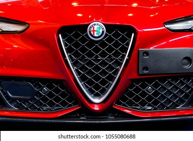 BUDAPEST, HUNGARY - MARCH 25, 2018: New Alfa Romeo logo on the front of a red Alfa Romeo Giulia sports car