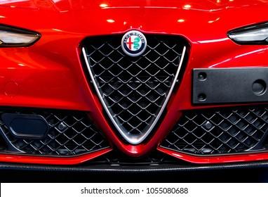 BUDAPEST, HUNGARY - MARCH 25, 2018: New Alfa Romeo logo on the front of a red Alfa Romeo Giulia sports car
