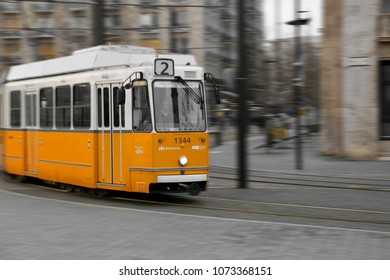 BUDAPEST, HUNGARY - MARCH 29TH 2018: The famous, touristical tram line 2 riding on the rails in the centre of Budapest, Hungary. The motion blur indicates the speed it's going. Illustrative editorial.