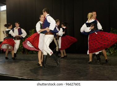 BUDAPEST, HUNGARY - MARCH 3: Polonez Folk Dance Group in traditional polish dressed performs on the stage of the 35th Travel � International Tourist Exposition on March 3, 2012 in Budapest, Hungary.