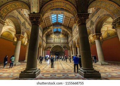 Budapest, Hungary - March 30, 2018 : Unidentified people watch the refurbished Romanian hall of the Budapest Fine Arts Museum. The exhibition will open again in October this year.