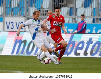 BUDAPEST, HUNGARY - MARCH 30, 2019: (l-r) Sandor Torghelle competes for the ball with Bence Szabo during MTK Budapest v DVTK OTP Bank Liga match at Hidegkuti Stadium.
