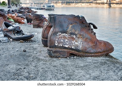 BUDAPEST, HUNGARY - MARCH 31, 2017: Two rusty boots in the memorial for the Shoes On The Danube, created by Can Togay and Gyula Pauer to commemorate Hungarian Jews who were victims of the Holocaust.