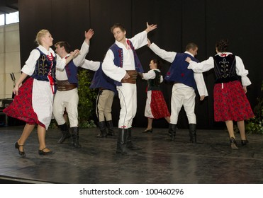 BUDAPEST, HUNGARY - MARCH 4: Polonez Folk Dance Group in traditional polish dressed performs on the stage of the 35th Travel - International Tourist Exposition on March 4, 2012 in Budapest, Hungary.