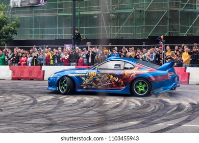 Budapest, Hungary - May 1, 2016. A Toyota Supra drifting car, drifts during a car show at the streets of the city of Budapest in Hungary, shot with panning view effect.