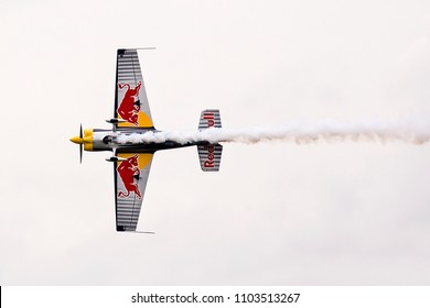 Budapest, Hungary - May 1, 2016. A Corvus Racer 540 Red Bull Air Race releases smoke during an open for the public air show at the city of Budapest.