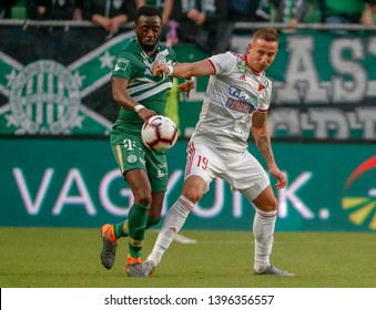 BUDAPEST, HUNGARY - MAY 11, 2019: (l-r) Abraham Frimpong fights for the ball with Daniel Zsori during Ferencvarosi TC v DVSC OTP Bank Liga match at Groupama Arena.