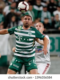 BUDAPEST, HUNGARY - MAY 11, 2019: (l-r) Daniel Bode battles for the ball in the air with Csaba Szatmari during Ferencvarosi TC v DVSC OTP Bank Liga match at Groupama Arena.